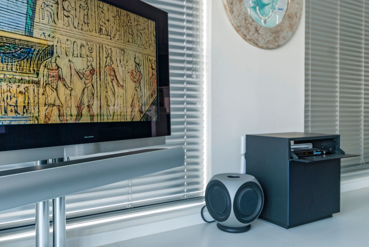 Floor standing Bang & Olufsen BeoVision 7 television with BeoLab 2 subwoofer
