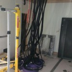 CAT6 Cables dropped from tray to rack location, ready for rack installation