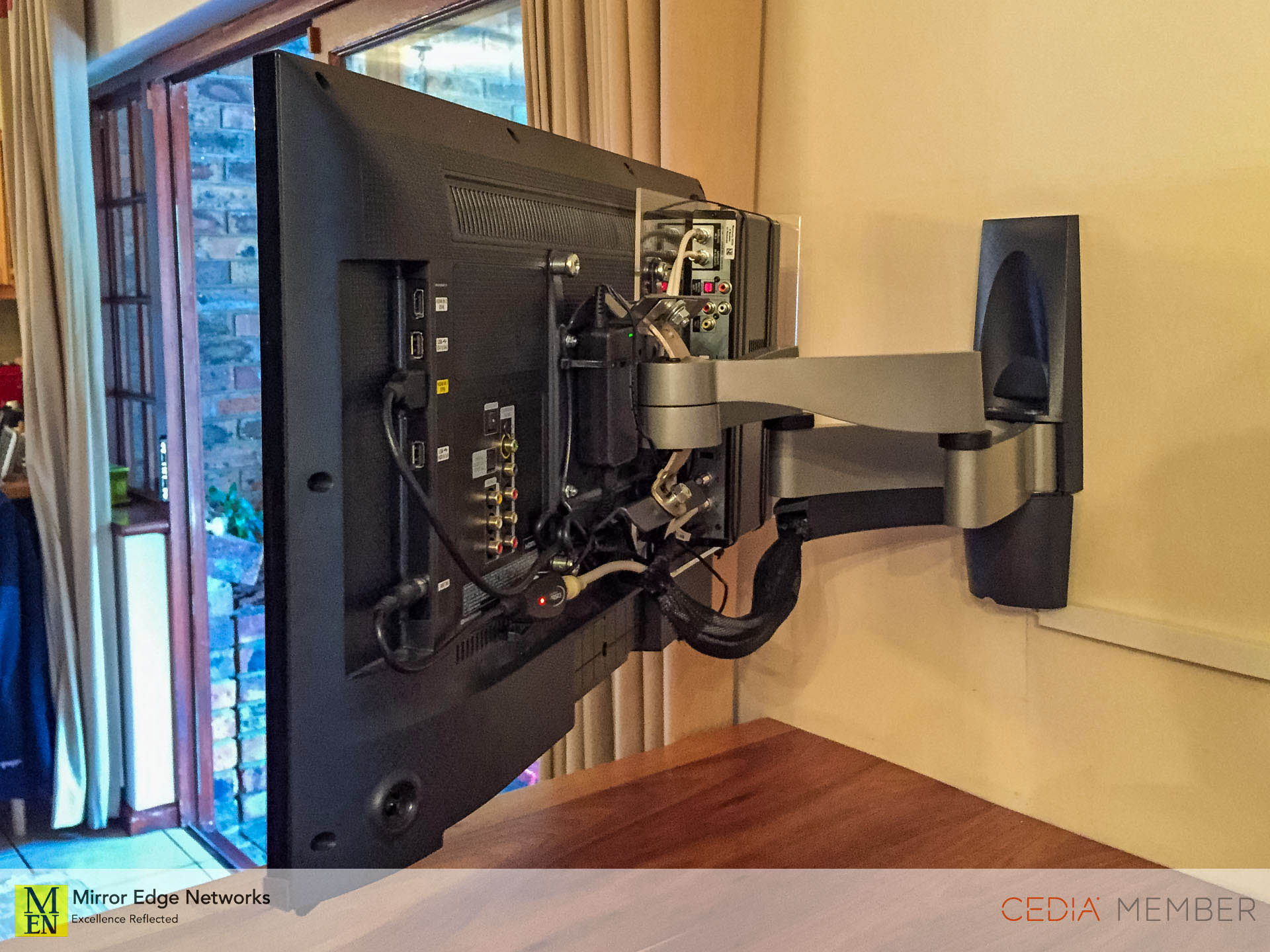 DSTV decoder mounted to the back of this Vogels television wall bracket