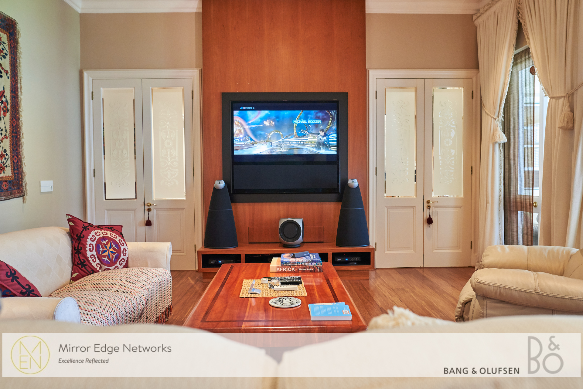 BeoVision 11-55 television installed on wall mount television bracket with BeoLab 9 floor standing HiFi speakers and BeoLab 2 subwoofer