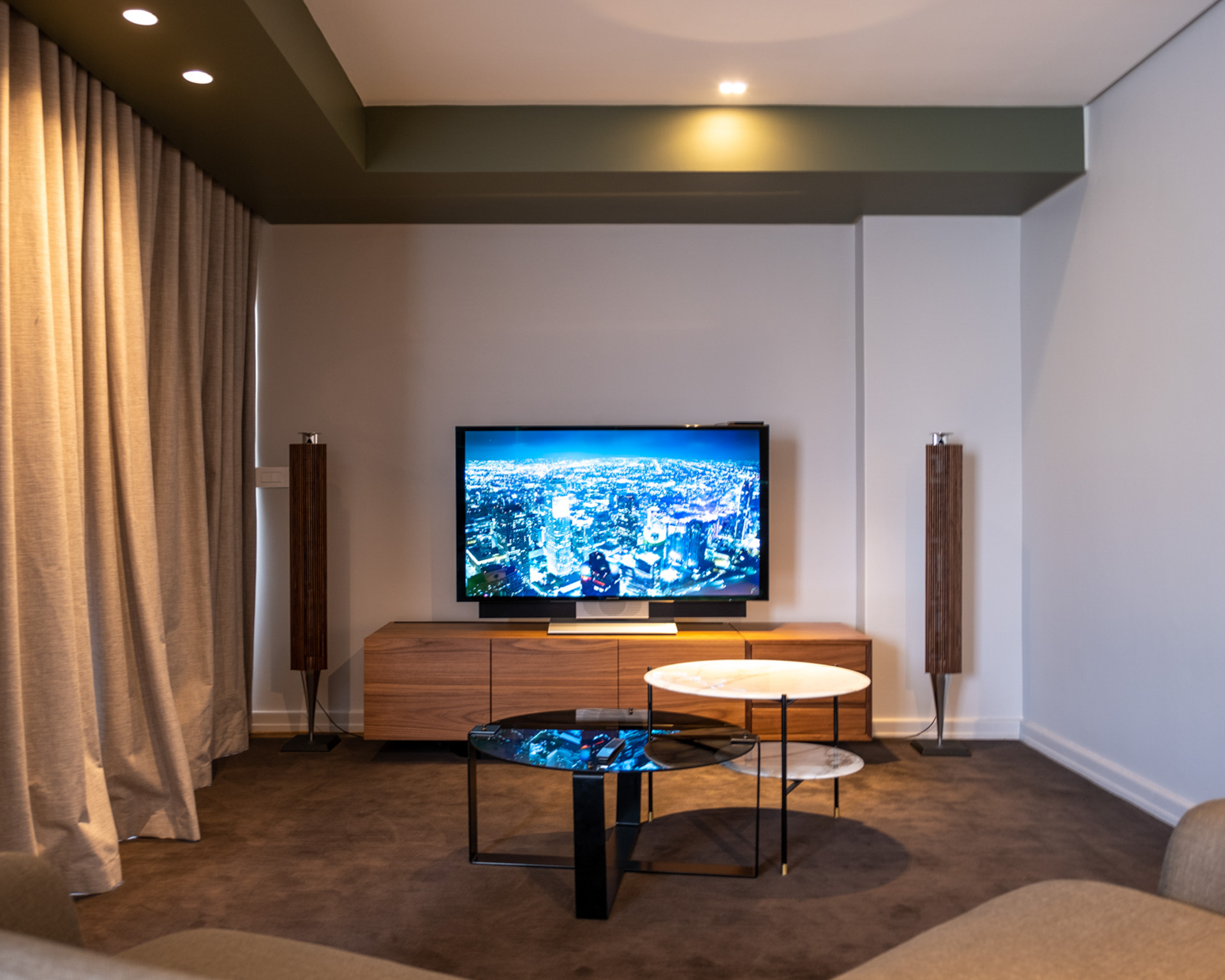 BeoVision Avant television installed onto cabinet with BeoLab 18 floor standing hifi speakers